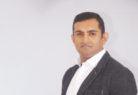 TM Praveen, Chief Executive Officer of Opus Consulting Solution