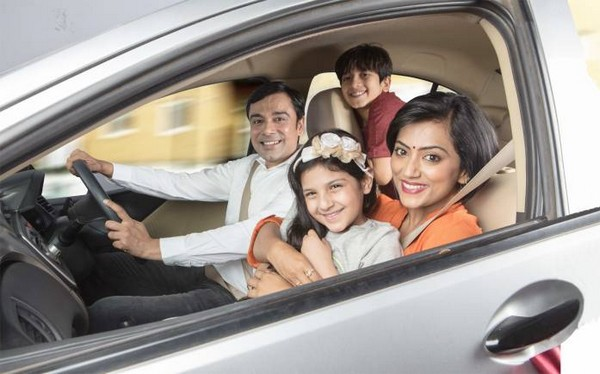 Indian family members in an SUV