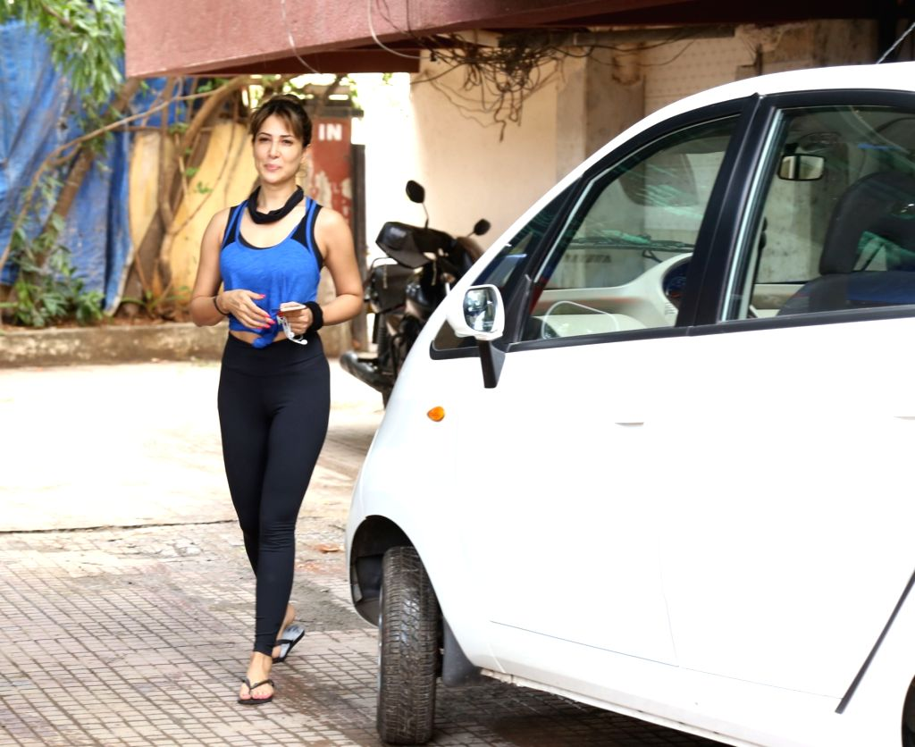 Kim Sharma going to gym on white tata nano