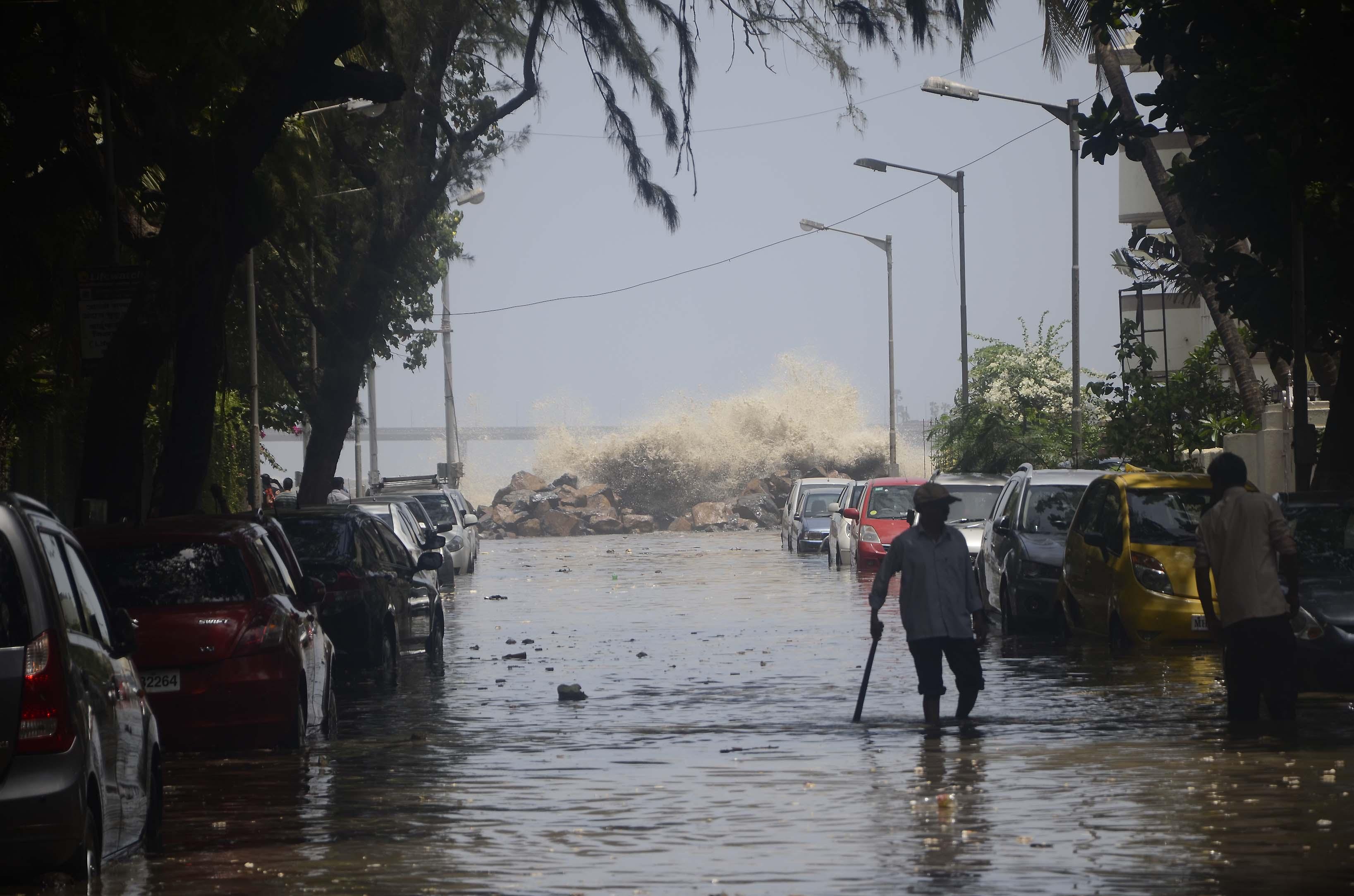 Monsoon elusive, Mumbai flooded by tidal waves